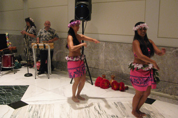 Hula dancers in the lobby kicking off the 7 W Hawaiian Luau