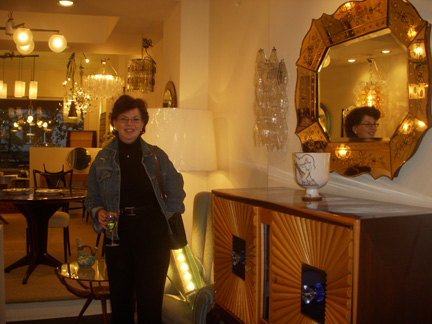 Interior Designer Esther Sadowsky standing next to one of the beautiful vignettes in the Gaspare Asaro Millenovecento Showroom