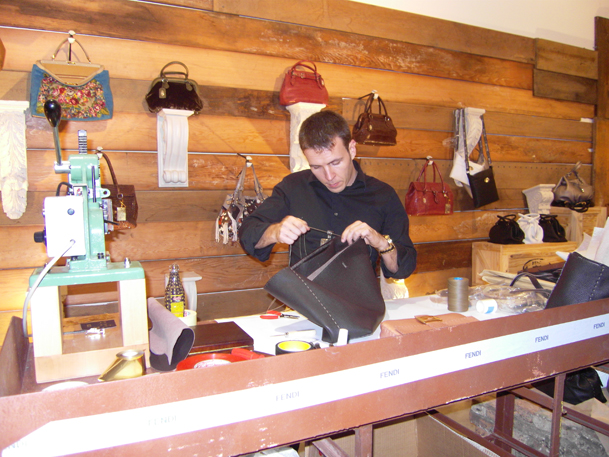A tight-lipped Cyril making Fendi purses.