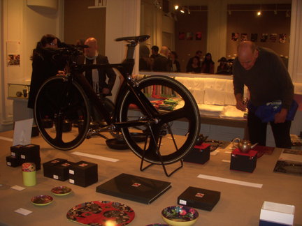 Products for sale include a lacquered bicycle by Alexander Gelman