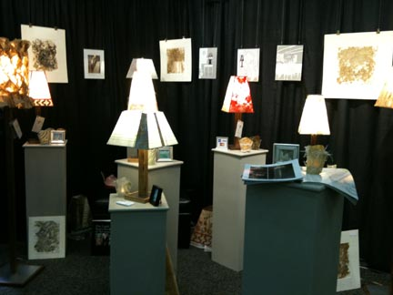 Beeline Studio LLC: Their line of products ranges from Teabag Lampshades and Lamps, Paintings, Tea Prints, Tea Paper Compositions, Drawings and Mixed Media. Booth: H20