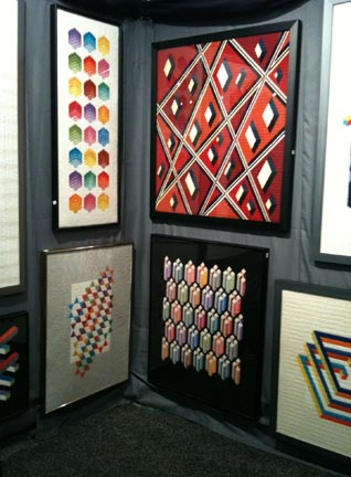 Geometric hand stitched fiber art wallhangings from David Nerwen. Booth: H26