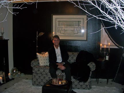 Thomas Plominski opted for a warm and classic black and white theme.  The couch he is sitting on is from GRANGE.