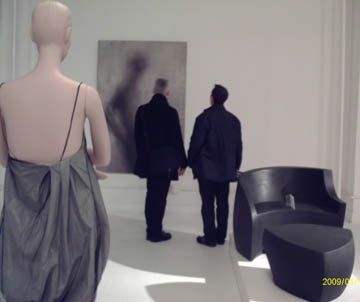 a Ralph Pucci mannequin overlooks a Vladimir Kagan chair and photography by Michner Spindler