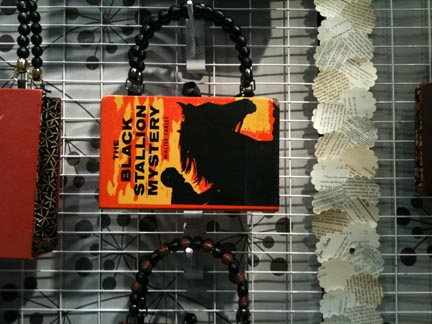 Rebound Designs gives old books a new life as one of a kind book purses.  For the gentlemen reader, they have paperback wallets made from well loved vintage paperbacks. Booth: I13.