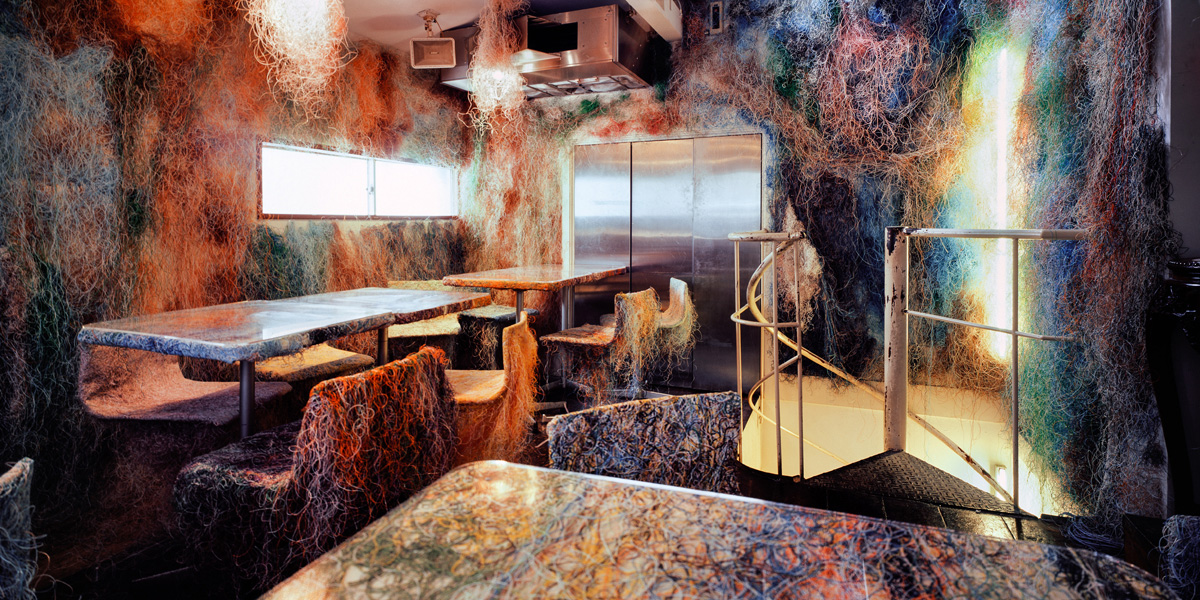 A Yakitori bar on the outskirts of Tokyo, decorated with a web of colored cables. Courtesy of Erieta Attali.